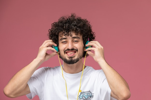 Young man taking off his headphone