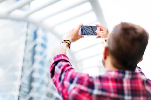 Young man taking photo smartphone concept Premium Photo