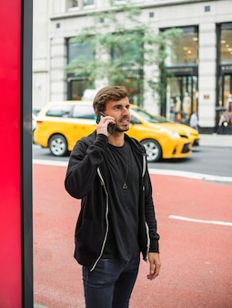 Young man talking on the phone on the street