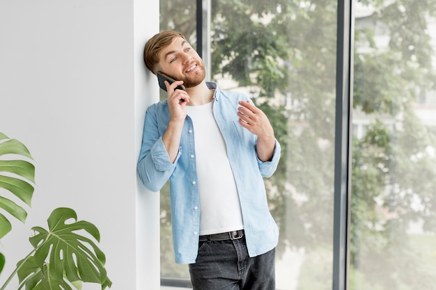 Young man talking over phone