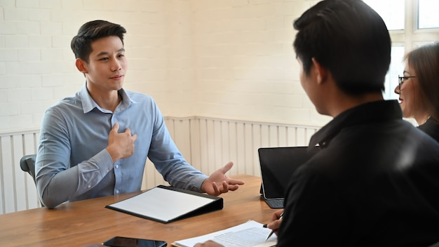 Young man talking with interview job in modern office.