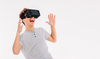 Young man teenager student wearing virtual reality glasses on wh