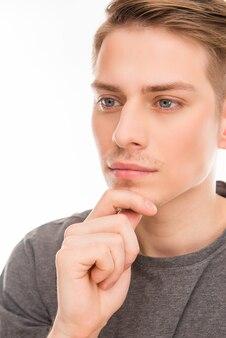 Молодой человек, касаясь его подбородка