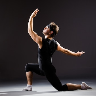 Young man training for ballet dances