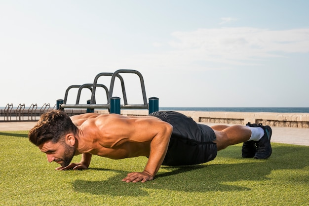Young man training exercise pushups