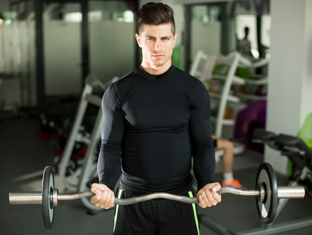 Young man training in the gym