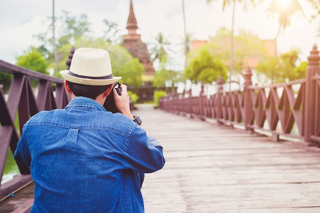 Young man travelers are enjoying archaeological attractions. and enjoy digital photography.