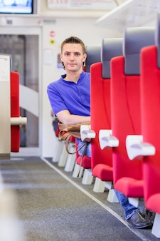 Young man traveling by train