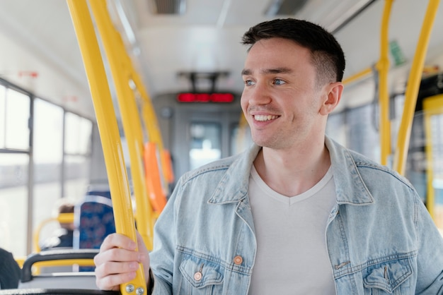 Young man travelling by city bus