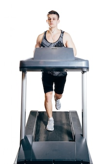 Young man on the treadmill
