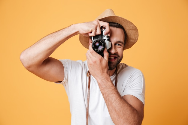 Young man trying to take photo