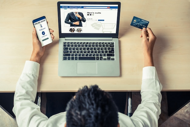 Young man use credit card for online shopping
