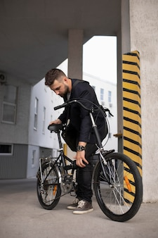 Young man using a folding bike in the city