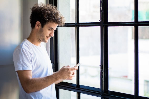 Young man using his smart phone.