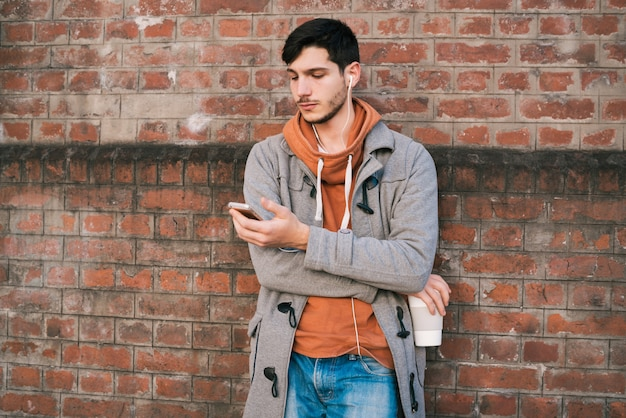 Young man using mobile phone.