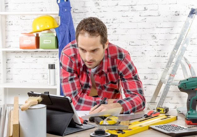 Young man using the tablet for diy