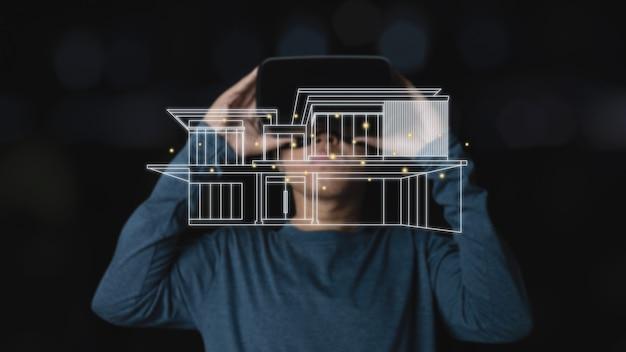 Молодой человек с помощью гарнитуры виртуальной реальности с эскизом дома. инвестиции в недвижимость и vr, будущее, онлайн-концепция технологий. темный фон.