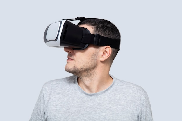 Young man using vr headset, experiencing virtual reality