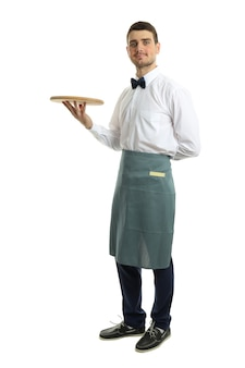 Young man waiter holds tray, isolated on white background.