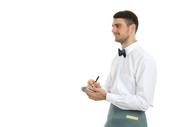 Young man waiter with notebook and pen, isolated on white background.