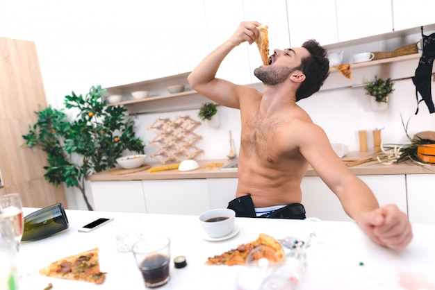 Young man wake up and having breakfast after party