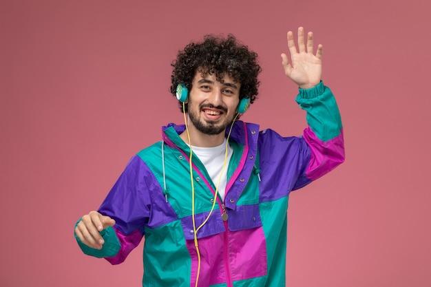 Young man waving his hand