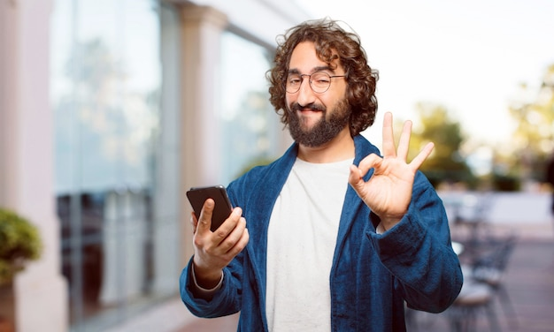 Young man wearing bathrobe night suit with a smart phone