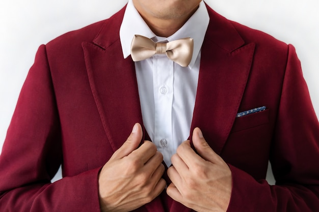 Young man wearing red suit with bow tie