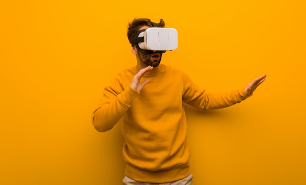 Young man wearing a virtual reality glasses