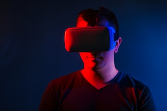 Young Man Wearing VR Headset And Experiencing Virtual Reality.