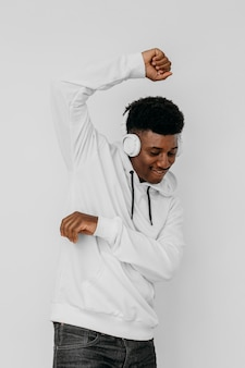 Young man wearing a white hoodie