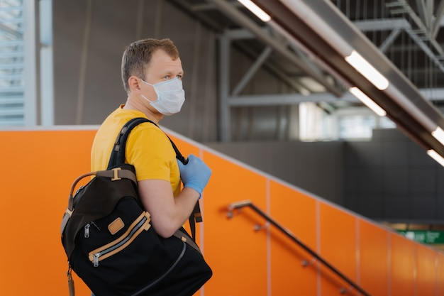 Young man wears medical mask and gloves to prevent from pneumonia outbreak