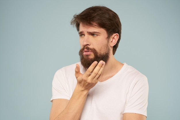 Young man in white t-shirt on isolated background cropped view of gesticulating with his hands. high quality photo