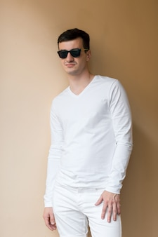 A young man in white wear