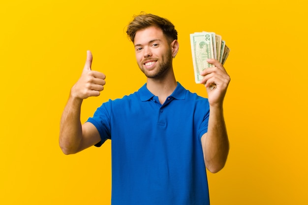Young man with banknotes  orange