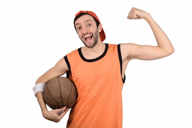 Young man with basketball ball.