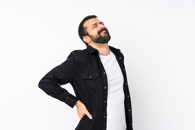 Young man with beard over isolated white  suffering from backache for having made an effort