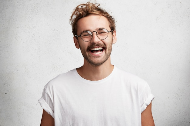 Young man with beard and round glasses