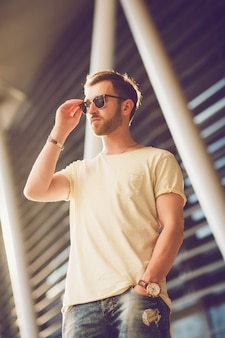 Young man with beard in sunglasses