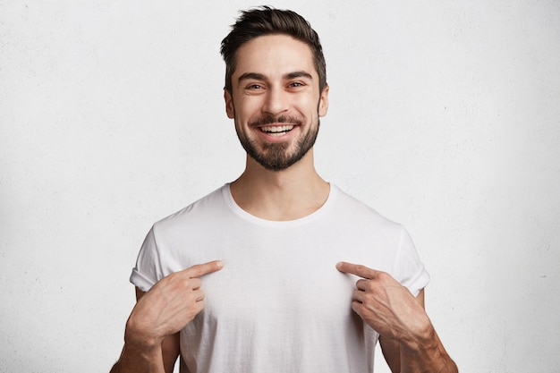 Young man with beard and white t-shirt