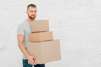 Young man with carton boxes