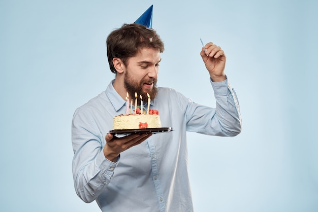 Young man with a celebratory cake