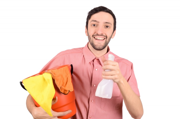 Young man with cleaning equipment.