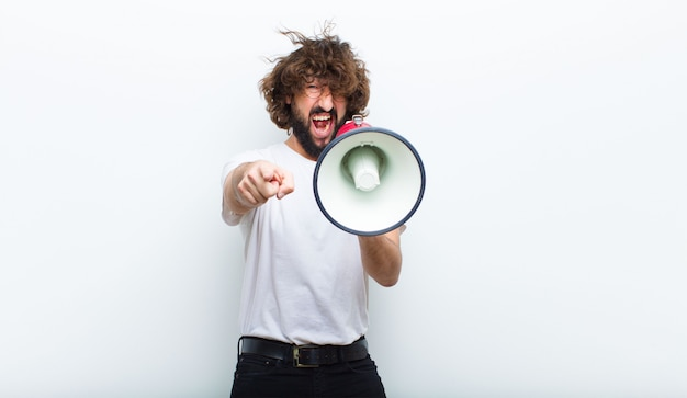 Young man with crazy hair in motion and shouting