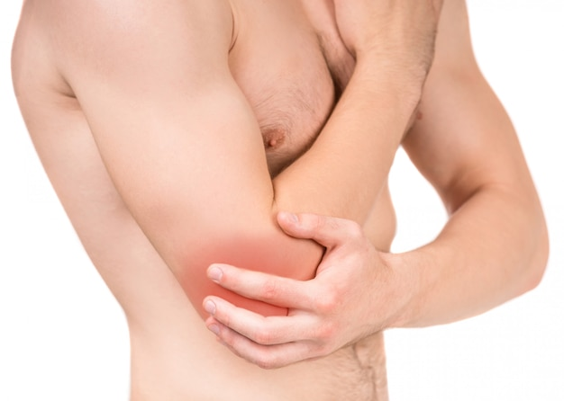 Young man with elbow pain isolated.