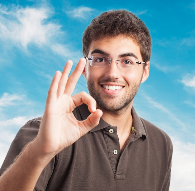 Young man with everything is ok gesture