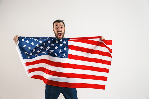 Young man with the flag of united states of america