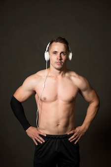 Young man with headphones at gym