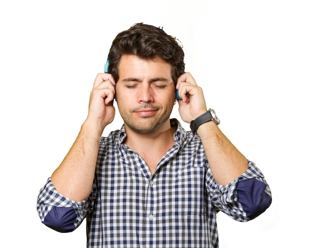 Young man with headphones isolated