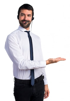Young man with a headset presenting something